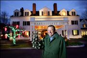 Chip Gray, owner of the Harraseeket Inn, shows off a set of sleigh bells in Freeport, Maine. Gray has made a tradition out of ringing the bells outside the inn after midnight on Christmas Eve to make the kids staying there think Santa's stopping by.  There is a growing trend of families who spend the holiday away from home to avoid all the cooking and fuss.
