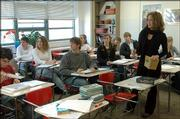 Susan Tate leads a Lawrence High School American Literature class in a discussion on writer Walt Whitman. Tate says good literature often carries a whiff of controversy but it's important to teach because it encompasses the history of all people.