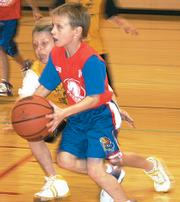 Terrapin Joel Spain works the corner as he gets to the basket Nov. 30 against the Yellow Jackets. The Terrapins continued their winning streak dating bak to the Hoopster preseason tournament by defeating the Yellow Jackets 40-6 in the second- and third-grade game.