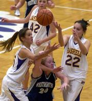 Haskell players Kortney Smith, left, and Whitney Warrior beat Westminster's Miranda Fields (20) to a loose ball in the Fightin' Indians' 72-46 victory. HINU won Tuesday at Haskell.