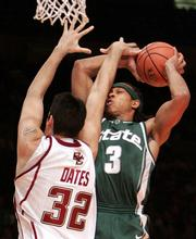 Michigan State's Shannon Brown, right, is fouled by Boston College's John Oates while going up for a shot during the first half of MSU's 77-70 victory. The Spartans won the second game of the Jimmy V. Classic on Tuesday in New York.