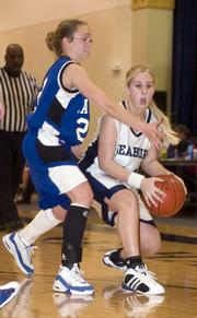 Seabury Academy's Gabrielle Dillon looks to pass as Kansas School for the Deaf's Kalina Johnson defends.