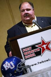 Kansas football coach Mark Mangino speaks at the Fort Worth Club during the formal announcement that Kansas will face Houston in the  Fort Worth Bowl on Dec. 23, 2005. Mangino attended the news conference Tuesday night in Fort Worth, Texas.