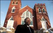 St. Luke AME Church pastor, the Rev. Verdell Taylor Jr., stands before the church, 900 N.Y., which has been placed on the National Register of Historic Places.