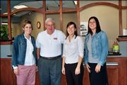 Lawrence radio personality Hank Booth, second from left, poses with Central National Bank employees, from left, Amanda Vail, Adele Bisel and Jen Haase after the Small Business Phon-a-thon Oct. 13. KLWN/KLZR radio sponsored a United Way Day on the radio to encourage gifts for the small business division of the United Way campaign.
