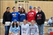 "Youth Volunteer Council members helped at ""Anna&squot;s House,"" a Women Build Project for Habitat for Humanity, on Nov. 5. Pictured are, back row, from left, Kim Wang, Eilish McGuinness, Jake Woodard, Cori Allen, Anna Harrington, Max Gregoire and Allyson Taylor; front row from left, Margaret Perkins-McGuinness, Kristina Taylor and Jennifer Taylor. Not pictured are Hannah Vick and Molly Sailors. Margaret Perkins-McGuinness, manager of the United Way&squot;s Roger Hill Volunteer Center, coordinates the Youth Volunteer Council activities."