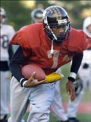 Appalachian State Quarterback Richie Williams practice on the school's campus.