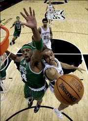Boston's Paul Pierce, left, pressures San Antonio's Tony Parker. The Spurs defeated the Celtics, 101-89, Friday night in San Antonio.