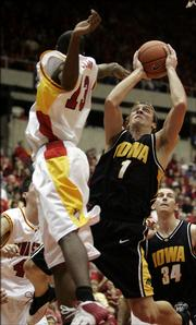 Iowa&#39;s Adam Haluska, right, looks to shoot in front of Iowa State defender Rashon Clark during Friday&#39;s game in Ames, Iowa. Haluska, who transferred from Iowa State after his freshman year, finished with 16 points in Iowa&#39;s 72-60 loss.