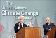 Former President Bill Clinton and Canadian Prime Minister Paul Martin, right,  speak to reporters Friday at the U.N. climate conference in Montreal.