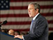 President Bush speaks at a Republican fundraiser for Rep. Mark Kennedy, R-Minn., Friday in Minneapolis. An AP-Ipsos poll found that Bush's approval rating has risen to 42 percent - the highest level since summer.