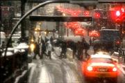 Commuters make their way through the snow that caused traffic problems Friday in New York.