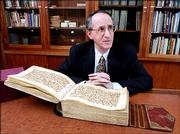 Don Skemer, curator of manuscripts for Princeton University, displays a holy Quran from the ninth century in his office in the Firestone Library of Princeton University. The ornate Quran, written in lavish Kufic script on delicate paper, is part of the largest collection of Islamic manuscripts in North America, amassed mostly by a Princeton University alumnus in the late 1800s and given to the university in 1942.