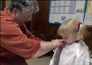 Barbara Crumet fits Lacey Greenfield, 5, for her angel costume before rehearsal on Dec. 1. North Lawrence Christian Church will be performing &quot;No Room For Jesus&quot; on Dec. 18.