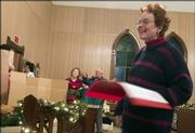 "Margie Hinkle directs members of the North Lawrence Christian Church during a rehearsal for their Christmas pageant, ""No Room For Jesus."" About 25 church members are participating or helping with the performance."