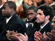 Heisman Trophy finalists, from left, Texas quarterback Vince Young, Southern California tailback Reggie Bush and USC quarterback Matt Leinart applaud during the start of the Heisman Trophy Award presentation show. Bush won the prestigious award Saturday in New York.