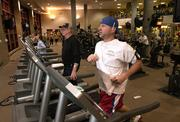 Kansas University alumnus Andy Frank catches some cardio Wednesday evening at Kansas University's Student Recreation Fitness Center. Many people move workouts indoors during winter.