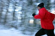 Advantages to running outdoors include wind drag and hilly terrain, which helps exercisers burn more calories.