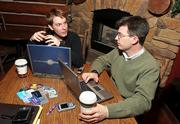 Jon Vernon, left, and Bob Butler launched CardAvenue.com for users to buy, sell or trade their unwanted gift cards. They meet regularly at Kayak's Coffee House in St. Louis to discuss their Web site.