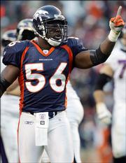 Denver's Al Wilson celebrates after the Broncos recovered a Baltimore fumble. The Broncos won, 12-10, Sunday in Denver.