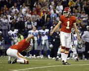 Chiefs kicker Lawrence Tynes (1) looks back at holder Dustin Colquitt (2) after missing what would have been an overtime-forcing 41-yard field goal against Dallas. The miss came in K.C.'s 31-28 loss Sunday at Dallas.