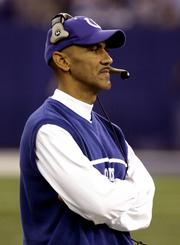 Indianapolis coach tony Dungy watches from the sideline as his team defeats the Pittsburgh Steelers, 26-7, in this Nov. 28 photo in Indianapolis. Dungy says the Colts aren't focused on going 16-0.