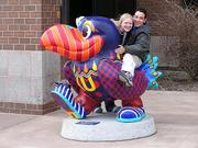 "Kansas University student Rodrigo Duque, right, and a friend visit the ""Mardi Gras on the Kaw Hawk,"" by Janet Perkins. Duque is on a mission to visit all of the Jayhawk statues, wherever they may be."