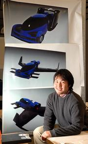 Yasuhiro Homma and a team of Kansas University students have been working on designs for a flying car. Homma, the team leader, displays computer renderings of the car, with wings retracted, at top, for driving, and with the wings extended, middle and bottom, for flying.