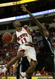 North Carolina State's Gavin Grant (11) drives to the basket as North Carolina Asheville's Joey Harrell defends. N.C. State won, 86-56, Wednesday in Raleigh, N.C.