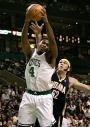 Boston's Ryan Gomes, left, hauls in a rebound against Indiana's Scot Pollard. The Celtics defeated the Pacers, 85-71, Wednesday night in Boston.