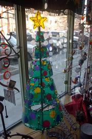 Alternatives to the traditional Christmas trees might include trees made of wire, stacked boxes or paper. This retro option is for sale at Waxman Candles, 609 Mass.