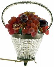The grapes, plums and leaves in this beaded glass basket are made of glass. The working lamp sold at a recent Heritage Galleries auction in Dallas for about $540.