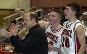 Stephen Vinson, right, and D.J. Watkins, center, cheer with LHS coach Chris Davis from the LHS bench in a file photo from the 2001-02 season.