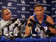 Kentucky's Randolph Morris, right, speaks about his reinstatement while coach Tubby Smith listens during a news conference Thursday at Memorial Coliseum in Lexington, Ky. The NCAA reinstated Morris' eligibility on the condition that he repay nine NBA teams for expenses related to tryouts and that he is withheld from 50 percent (14 games) of the current season.