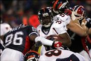 Buffalo's Jeff Posey (96) tackles Denver's Mike Anderson in the first quarter of the Broncos' 28-17 victory. Denver won Saturday night in Orchard Park, N.Y.