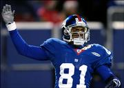 Giants wide receiver Amani Toomer reacts after scoring on a 31-yard catch in the fourth quarter.