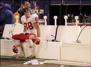 Kansas City tight end Tony Gonzalez glances at the scoreboards after the Chiefs' loss to the Giants.