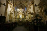 People pray at the church of San Gabriel in Cholula, Mexico. Cholula has several dozen elaborately decorated churches.