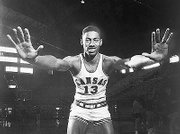The 7-foot-1 Wilt Chamberlain played basketball at Kansas University in the 1950s, when many businesses and institutions still practiced overt racism. Aram Goudsouzian, a history professor at the University of Memphis, has written an article exploring Chamberlain's role in changing the American landscape in the context of sports and racism.