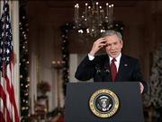 President Bush gestures during a news conference in the East Room of the White House. On Monday Bush insisted that his domestic spying program was an effective tool in disrupting terrorists, and not an abuse of Americans' civil liberties.