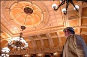 Paul Hotchkiss of EverGreene Painting Studios of New York views the company's completed work on the ceiling of the recently renovated Senate chamber at the state Capitol in Topeka.