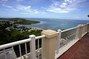 A balcony at the El Conquistador Resort in Fajardo, Puerto Rico, has an expansive ocean view, as seen in this Aug. 30, 2005, file photo. Rep. Tom DeLay, R-Texas, has visited many high-end resorts around the U.S. and abroad, all in the name of raising money for the Republican party.