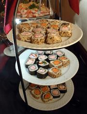 Sushi is an easy finger food to serve at parties; Maceli's Catering, 1031 N.H., offers it along with other hors d' oeuvres.