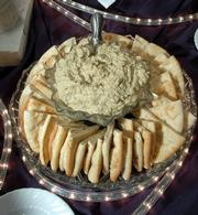 Hummus and pita wedges offer a simple recipe for easy entertainment over the holidays. These appetizers were prepared for a recent party by Maceli's, a catering business at 1031 N.H.