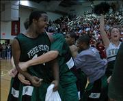 Free State High's Christian Ballard lets out a celebratory yell after the Firebirds' 58-54 victory. FSHS won Thursday at LHS.