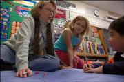 Gerry Bukaty, a third-grade teacher at Sunflower School, is the Lawrence school district's nominee in the Kansas Master Teacher Award Program. Bukaty has been a teacher in Lawrence for 19 years. She  worked on a math exercise this week with students Halley Johnston, center, and Su Won Bak.