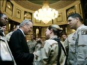 U.S. Secretary of Defense Donald H. Rumsfeld, left, meets troops at the Al Faw Palace in Baghdad, Iraq. Rumsfeld arrived unannounced Thursday in Baghdad to hold talks with U.S. commanders and assess the next phase of U.S. troop deployments in Iraq.