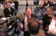 Kansas head coach Mark Mangino talks with members of the media during Thursday's press conference in Fort Worth.