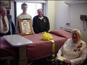 The Scottish Rite Masons dedicate Lawrence Memorial Hospital Palliative Care Room 217 in the memory of George Mole during a ceremony Dec. 4. From left are Danny Keller, assistant representative of the Scottish Rite Masons; Dalton Walsh, great-grandson of George Mole; Tom Wilkerson, executive secretary of the Scottish Rite Masons; and Betty Mole, wife of George Mole.