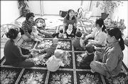 "A group of mothers meet for a ""playdate,"" at the San Jose, Calif., home of Julie Steinbrinck, top left, and her 7-month-old daughter, Gracie. Experts say it is important for new mothers to make friends who also have babies."